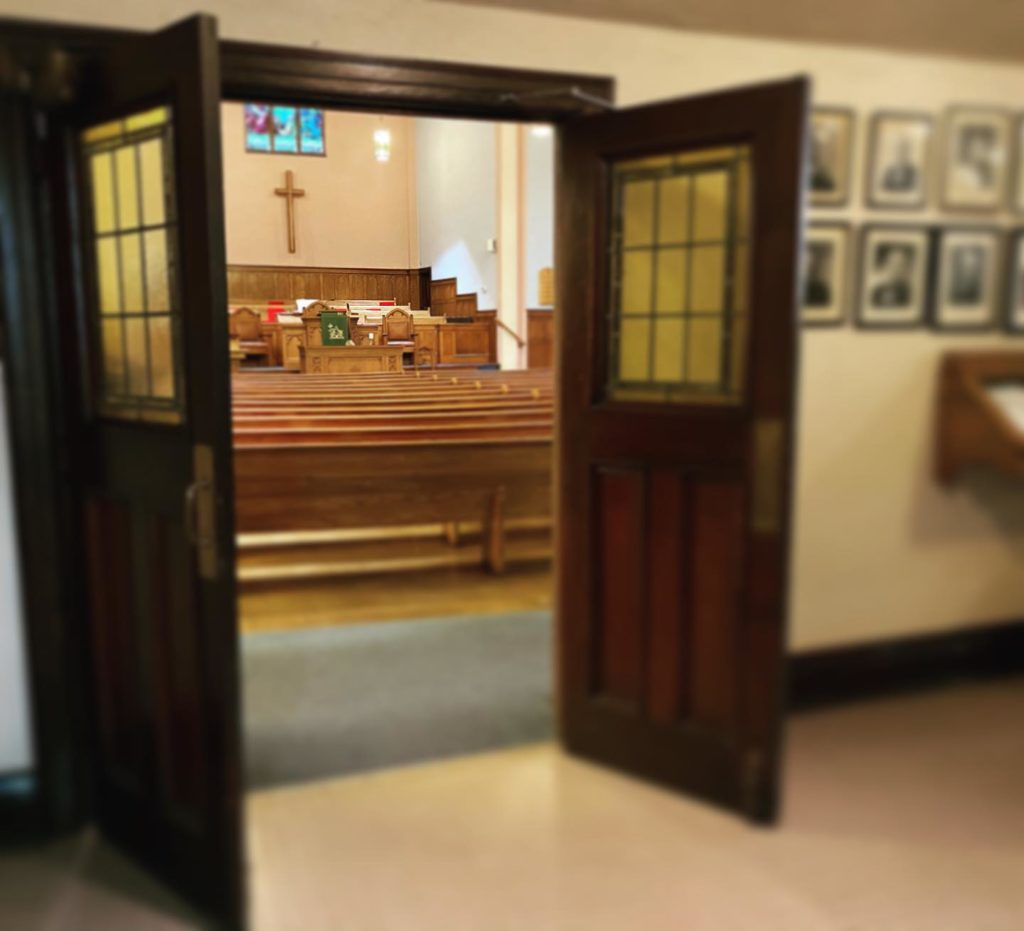 Looking into the Sanctuary from the foyer, through open double doors.